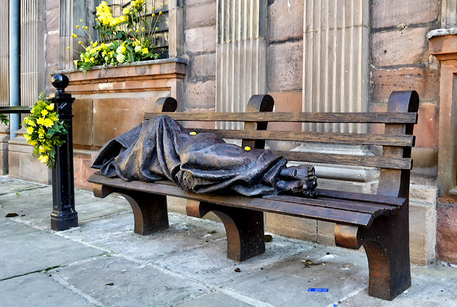 Photograph of sculpture depicting 'homeless jesus'